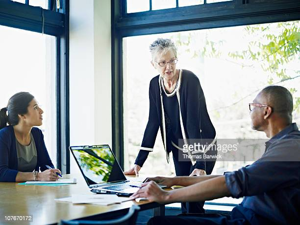 Coworkers in discussion at conference table