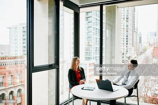 Coworkers in discussion during informal meeting