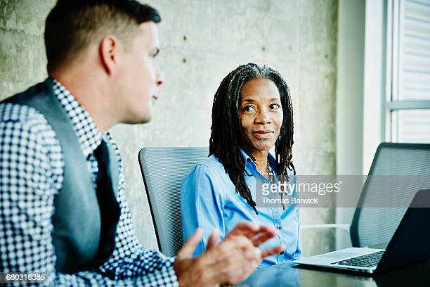 Coworkers in discussion during project meeting