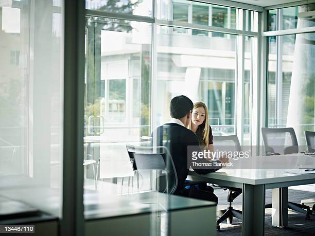 Coworkers in discussion in conference room