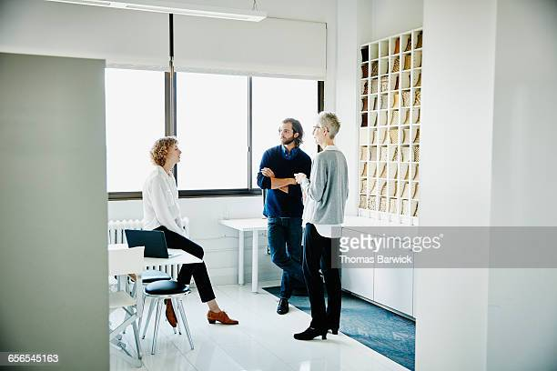 Coworkers in discussion in design office
