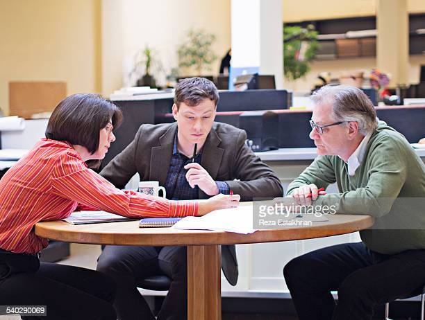 Coworkers in discussion over plans