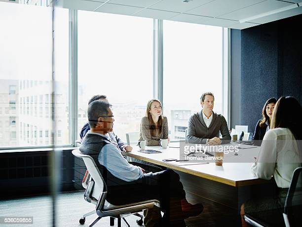 Coworkers in morning meeting in conference room