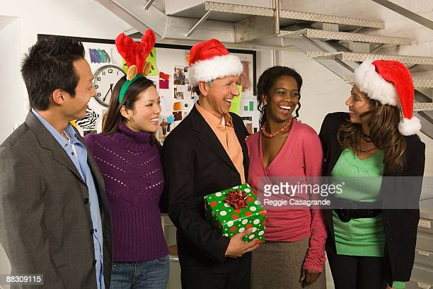 Co-workers in office at Christmas
