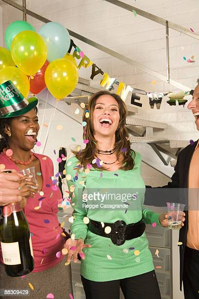 co-workers in office celebrating new years eve party - 25 29 years stock pictures, royalty-free photos & images