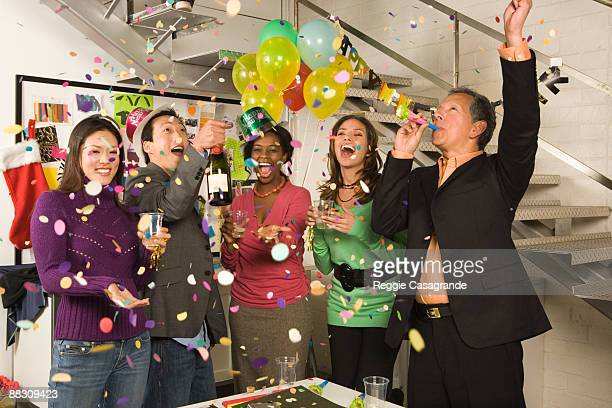 Co-workers in office having a New Year's Eve party