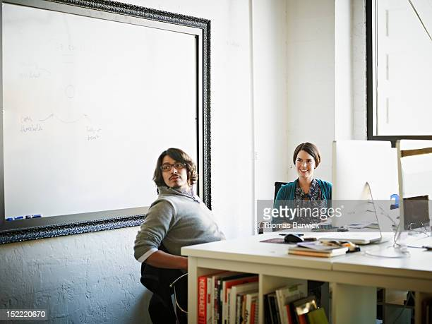 Coworkers in office listening to discussion