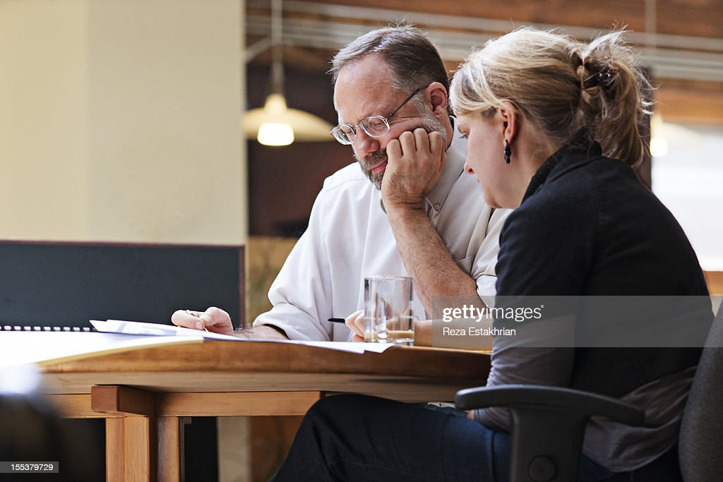 Coworkers in small meeting : Stock Photo