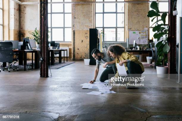 Co-workers in startup business with business documents