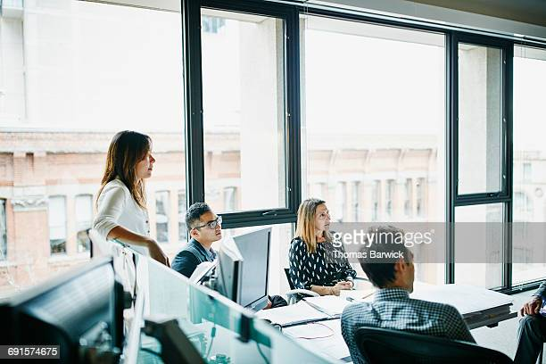 Coworkers in team meeting at office workstation