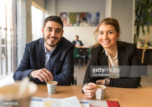 co-workers in the kitchen take a break to drink takeaway coffee - coffee drink stock pictures, royalty-free photos & images