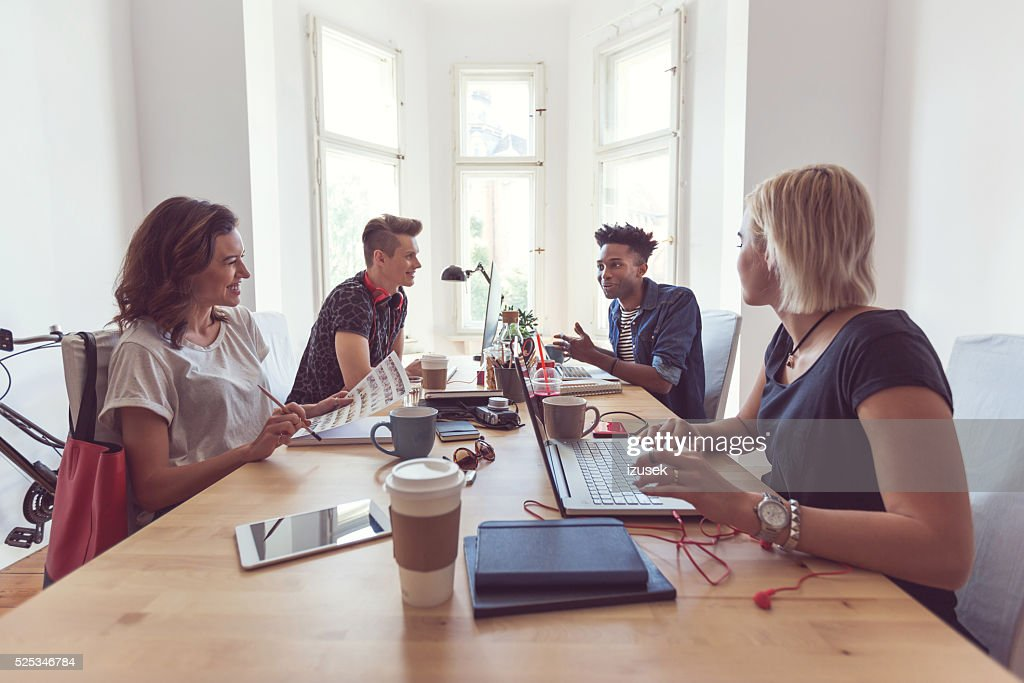 Co-workers in the office : Stock Photo