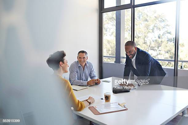 Coworkers making conference call in meetingroom