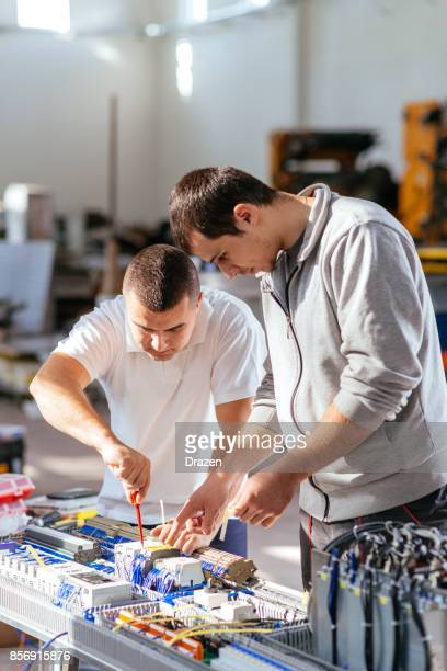 Coworkers on production line in factory