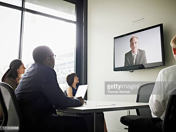 Coworkers participating in video conference call