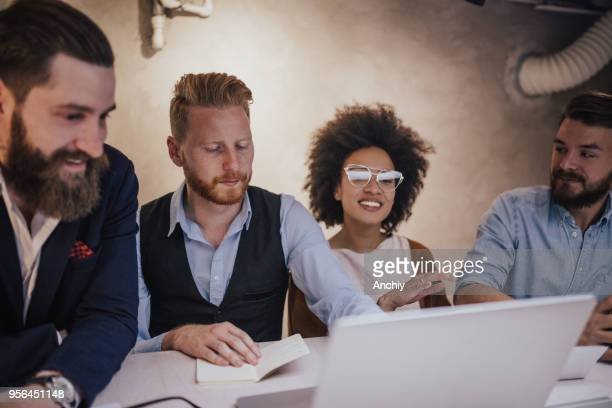 coworkers performing prospect research - ginger banks stock photos and pictures