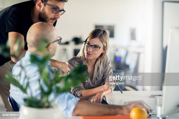 co-workers - creative director stock pictures, royalty-free photos & images