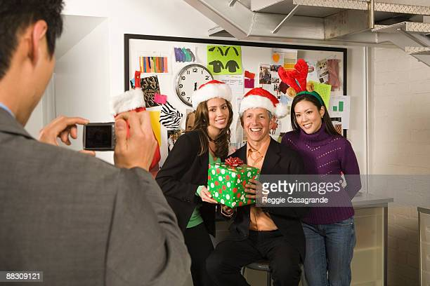 Co-workers posing for holiday picture