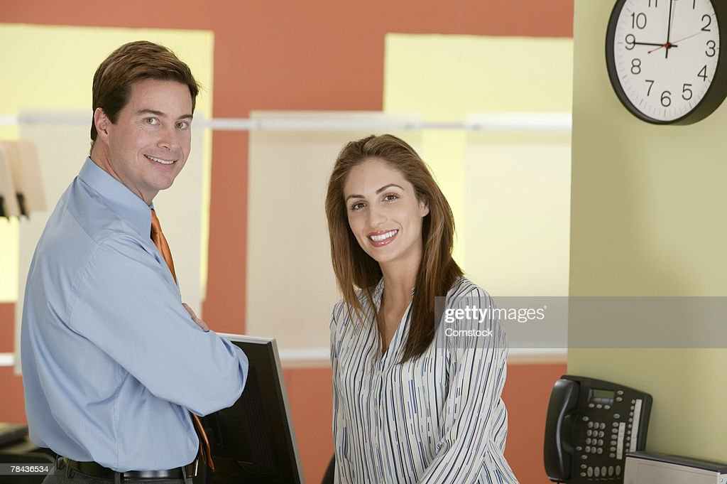 Co-workers posing in the office : Stockfoto