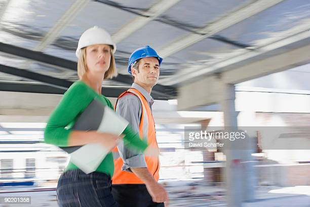 Co-workers rushing across construction site