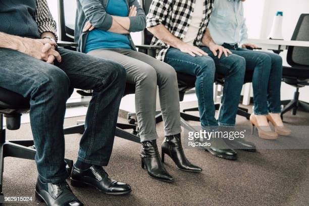 coworker's shoes photo - jeans stock pictures, royalty-free photos & images