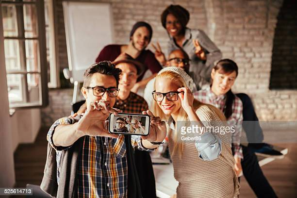 Coworkers taking a photo of themselves