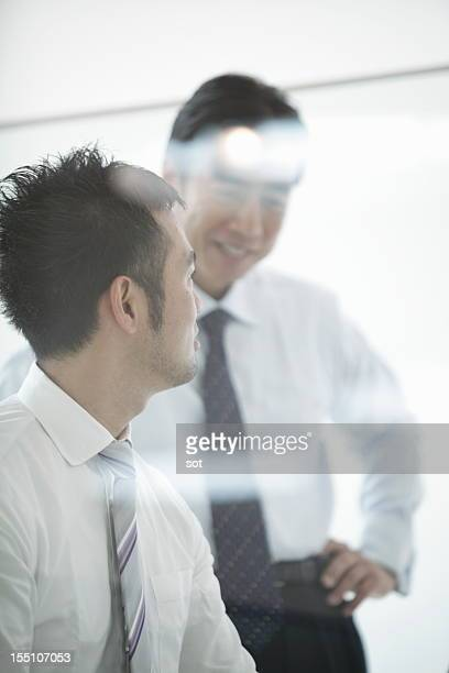 Coworkers talking in conference room