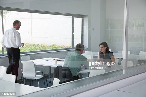 Co-workers talking in conference room