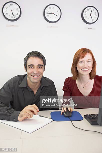 Co-workers using computer