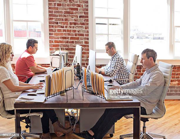 Coworkers work on individual projects