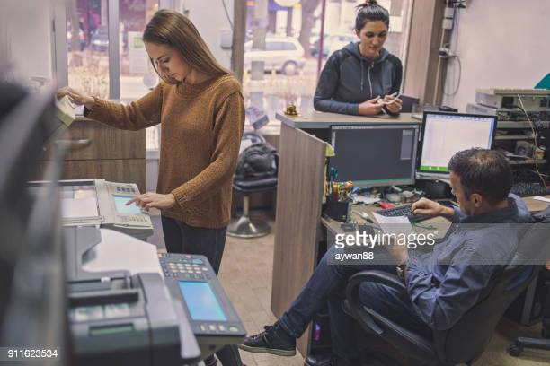coworkers working at the office - copying stock pictures, royalty-free photos & images