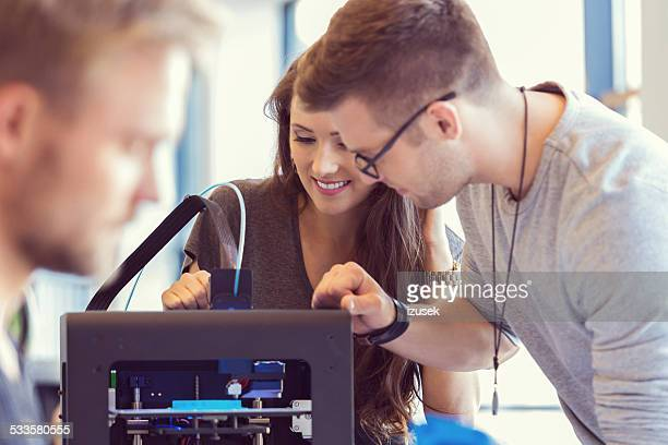 Coworkers working in an 3D printer office