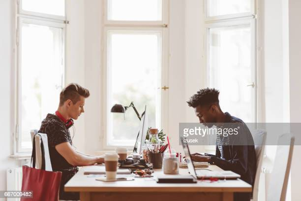 Coworkers working in small office