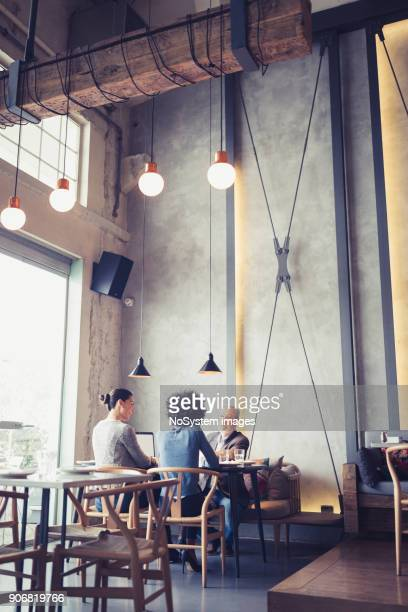 Co-Working Space in High-End Restaurants. Businesspeople having meeting In a restaurant.