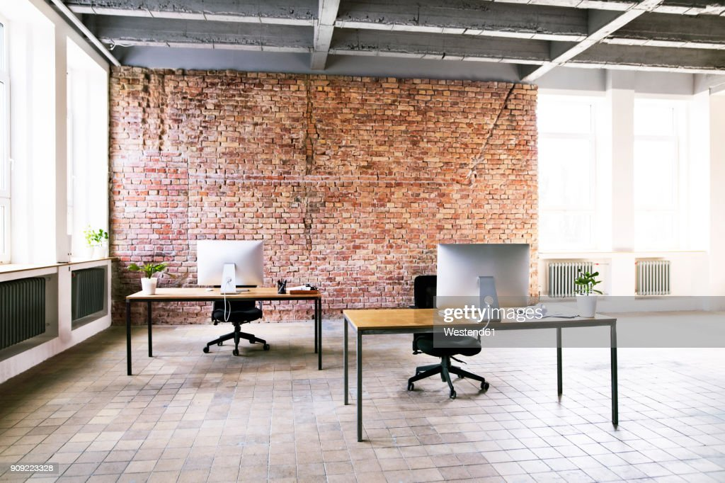 Coworking space with brick wall in office : Stock Photo