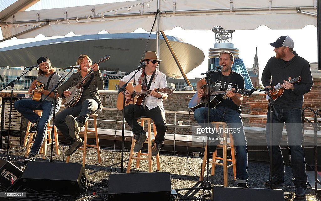 Co-writer Brad Warren, Keith Urban, co-writers Kevin Rudolf, Brett Warren with producer Nathan Chapman perform as Keith Urban, BMI & ASCAP Celebrate the No. 1 Song 'Little Bit Of Everything' at Aerial In Nashville on October 7, 2013 in Nashville, United States.