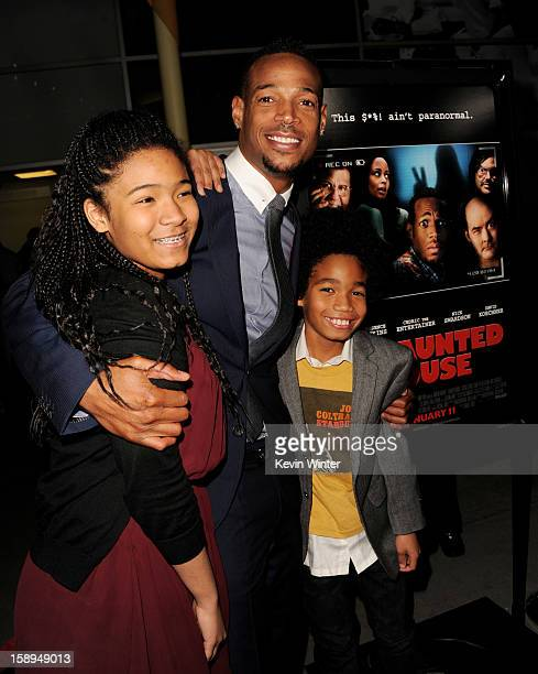 Cowriter/producer/actor Marlon Wayans and his daughter Amai and son Shawn pose at the premiere of Open Road Films' A Haunted House at the Arclight...