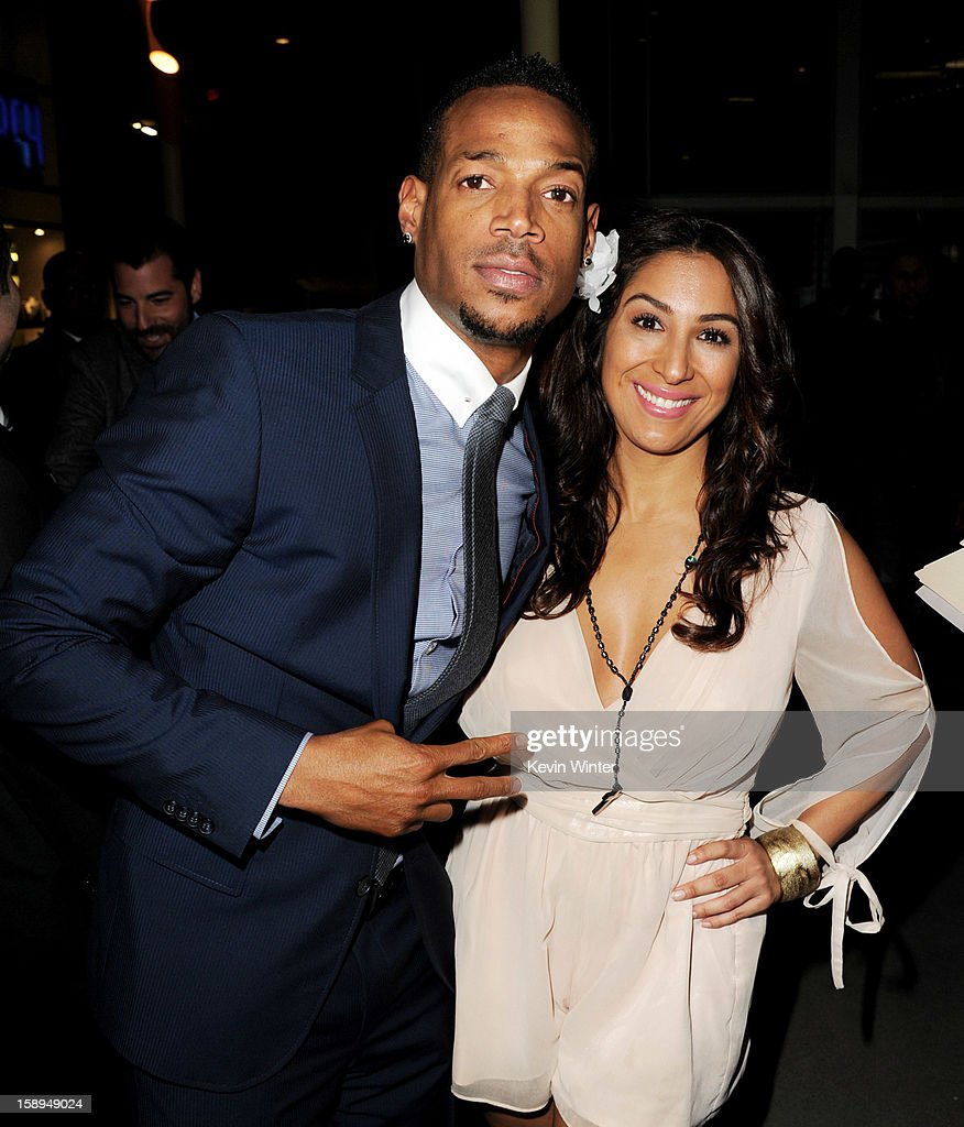 Co-writer/producer/actor Marlon Wayans (L) and Liana Mendoza arrive at the premiere of Open Road Films' 'A Haunted House' at the Arclight Theatre on January 3, 2013 in Los Angeles, California.