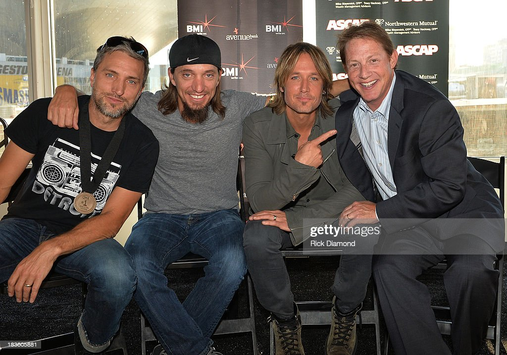 Co-writers Brett Warren and Brad Warren with Keith Urban and Clay Bradley of BMI pose as Keith Urban, BMI & ASCAP Celebrate the No.1 Song 'Little Bit Of Everything' at Aerial In Nashville on October 7, 2013 in Nashville, United States.