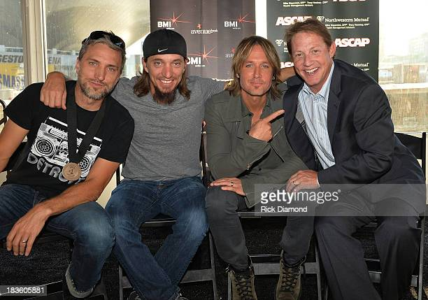 Cowriters Brett Warren and Brad Warren with Keith Urban and Clay Bradley of BMI pose as Keith Urban BMI ASCAP Celebrate the No1 Song 'Little Bit Of...