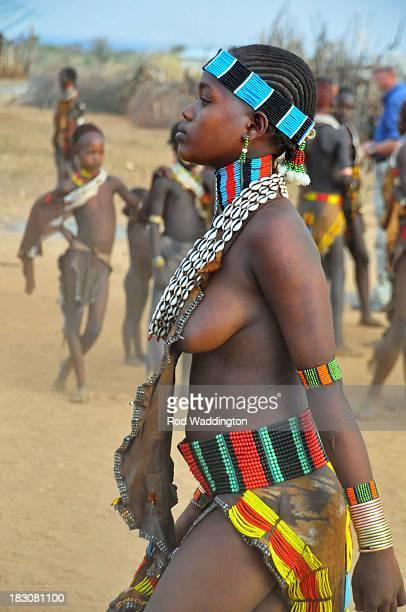Cowry shells, beads goat skins make up the attire of the Hamer women.