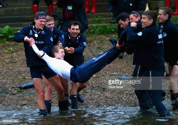 Cox Laurence Harvey of Cambridge is thrown into the Thames by his crew after victory during the BNY Mellon 160th Oxford versus Cambridge University...