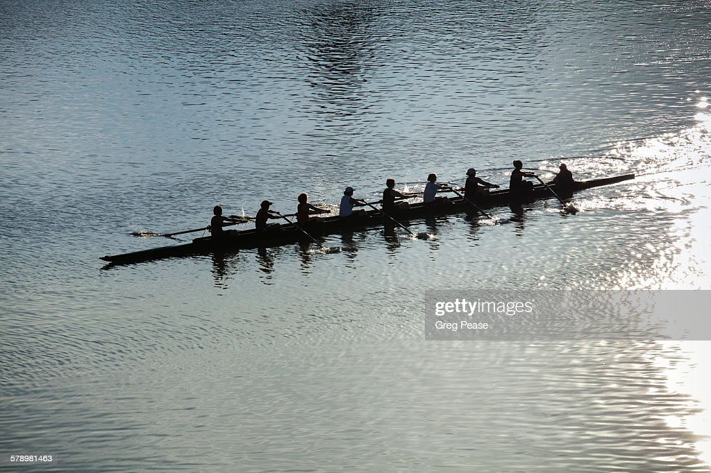 Coxed eight sweep rowing team at sunrise : Stock Photo