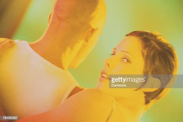 Coy couple toned orange