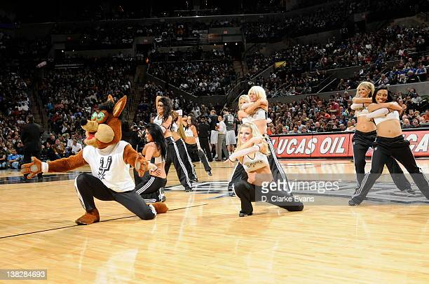Coyote and the Silver Dancers of the San Antonio Spurs perform during a break in the game against the Oklahoma CIty Thunder on February 4 2012 at the...