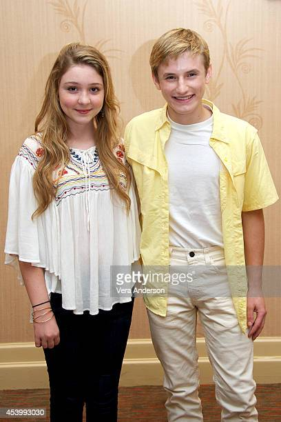 Cozi Zuehlsdorff and Nathan Gamble at the Dolphin Tale 2 Press Conference at the Sheraton Sand Key Resort on August 19 2014 in Clearwater Florida