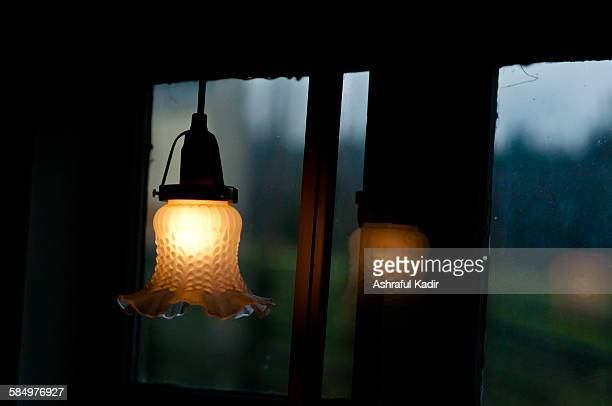 Cozy, ambient corner with a light bulb near window