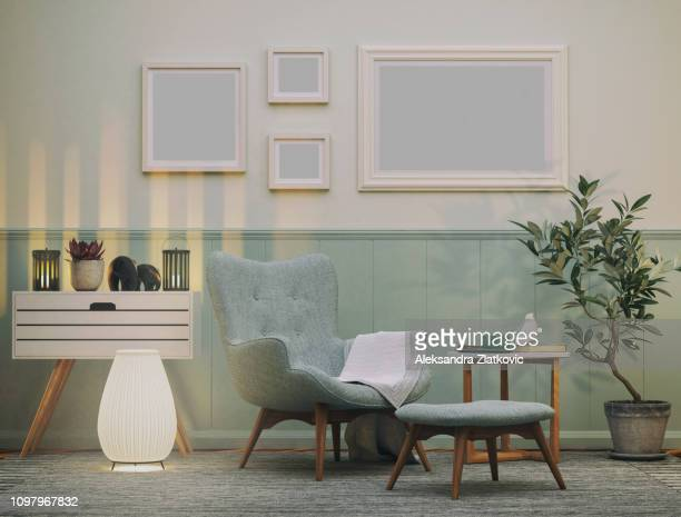 cozy armchair in the living room - indoors stock pictures, royalty-free photos & images
