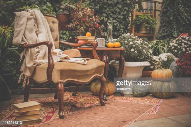 cozy autumn garden - garden decoration stock pictures, royalty-free photos & images