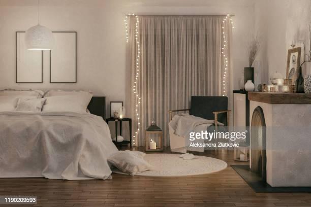 コージー ベッドルーム - ストリングライト ストックフォトと画像